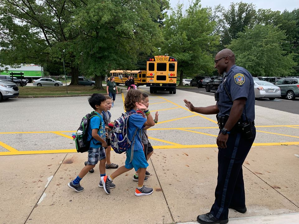 Abington Police officer participating in a high-five Friday initiative
